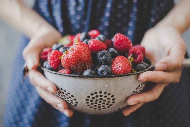 Organic fresh berries. Hands holding fresh juicy berries, closeup stock image