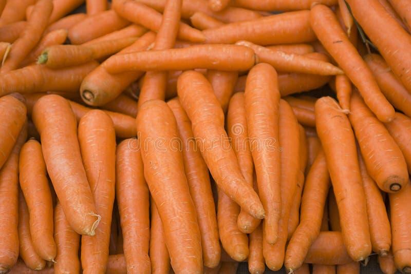Organic and fresh carrots in the bazaar stock photos
