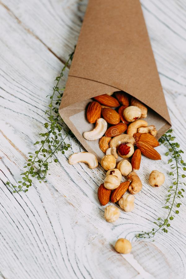 Organic fresh harvested mix nut in paper sack. Mix Organic nut in a Kraft package royalty free stock photos