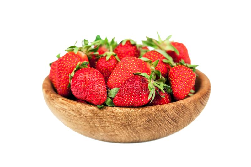 Organic fresh ripe strawberry in a wooden bowl isolated on a white background. Healthy fruits and berry, vegaterian food stock photos
