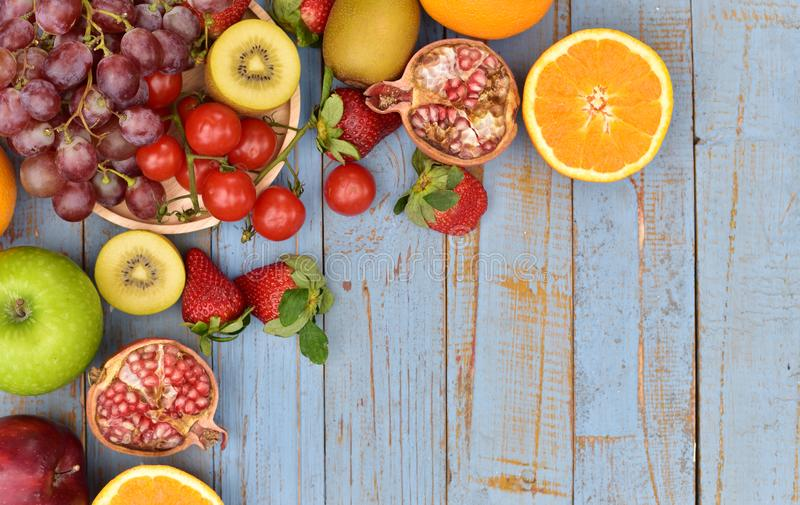 Organic fruits on wooden table royalty free stock photography