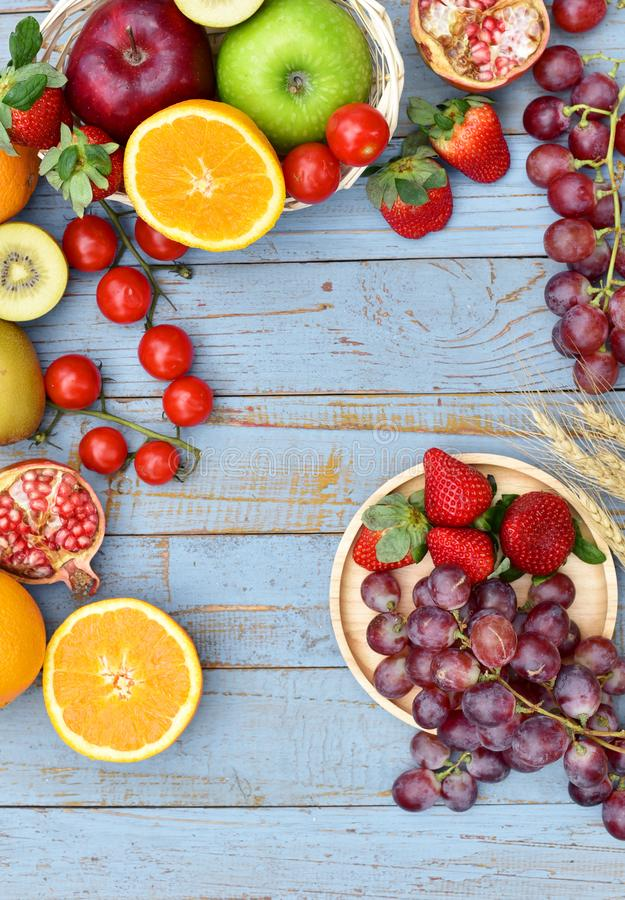 Organic fruits on wooden table royalty free stock photos