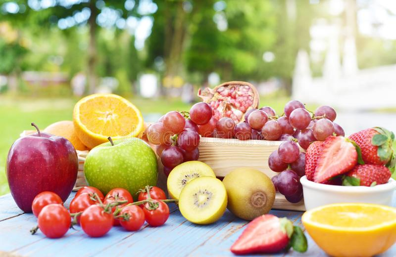 Organic fruits on wooden table royalty free stock photo