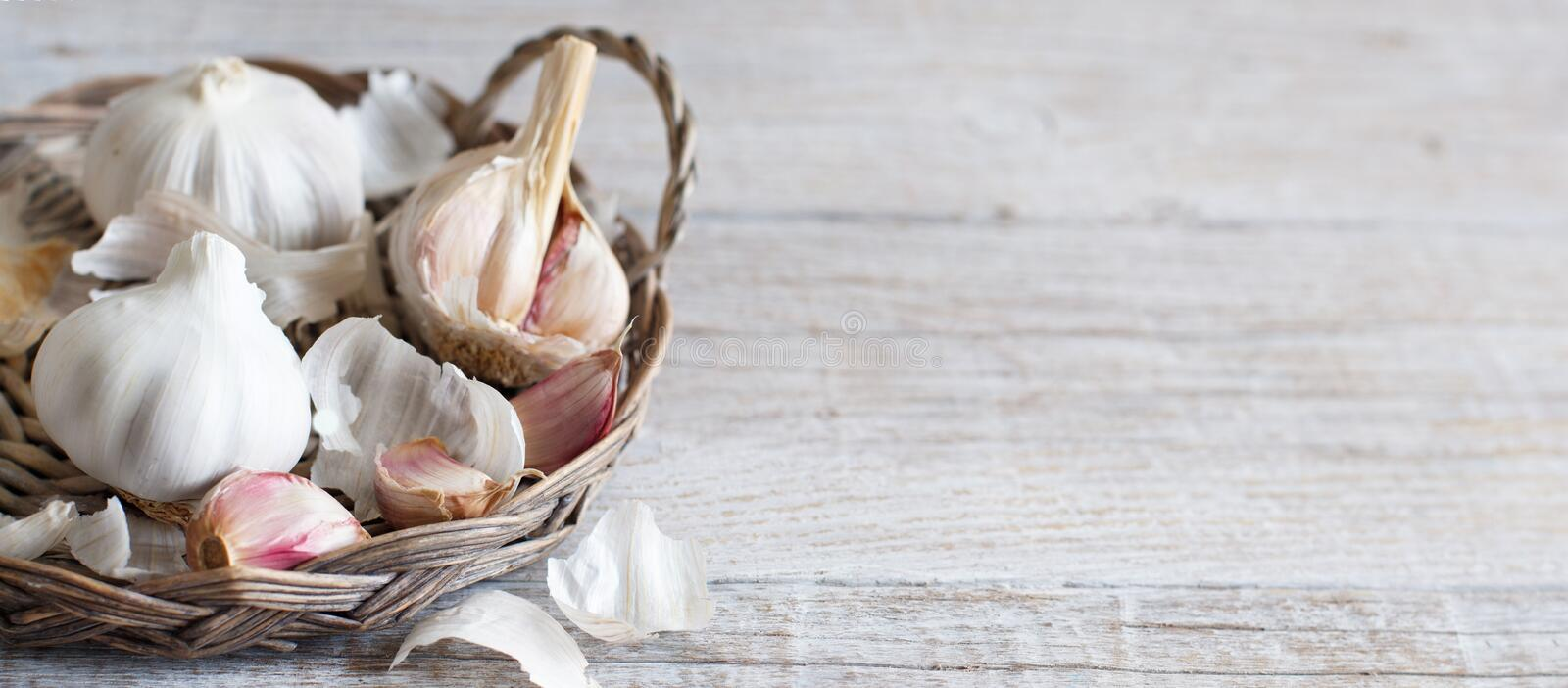 Organic garlic on wooden table. Organic garlic on the old wooden table close up stock photos
