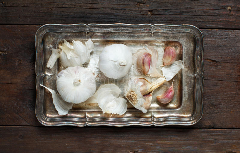 Organic garlic on wooden table. Organic garlic on the old wooden table top view royalty free stock photos