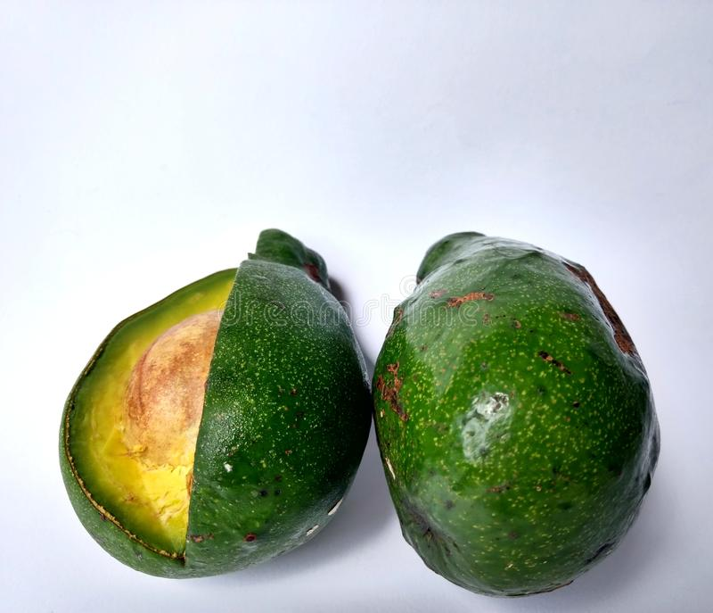 Organic green avocados on white background. ingredient for guacamole royalty free stock photo