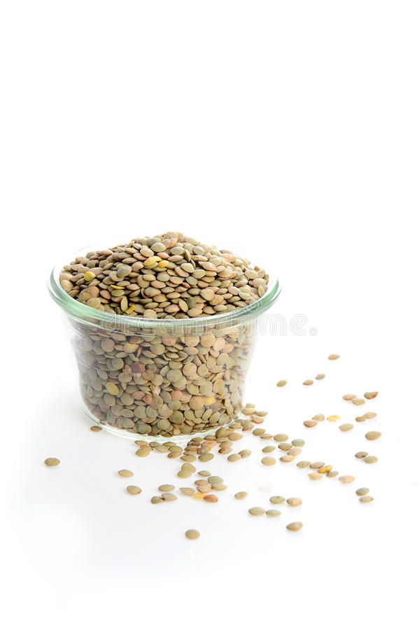 Organic green lentils for healthy food isolated on white stock image