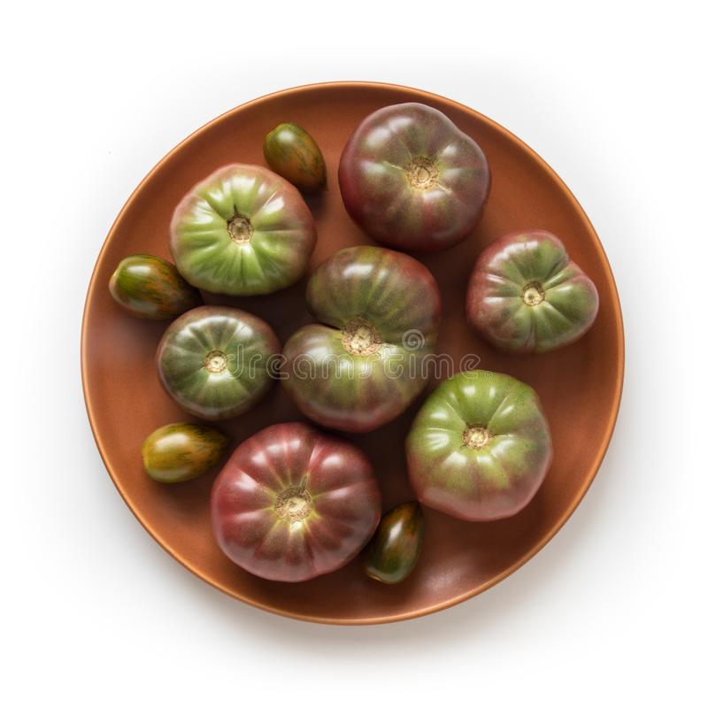 Organic heirloom Brandywine tomatoes on a plate, stock photography