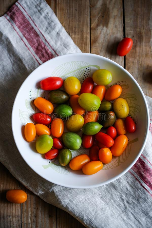 Organic Heirloom Cherry tomatoes pickled stock images