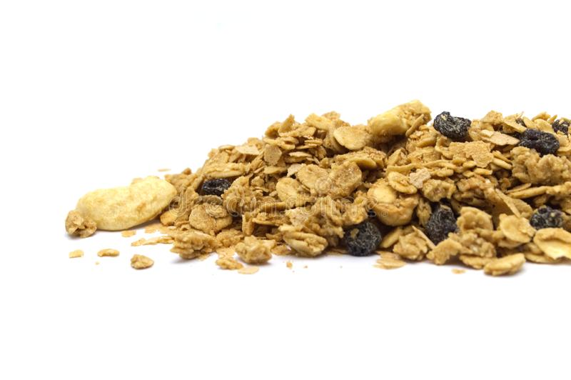 Organic homemade crunchy Granola cereal pile on white background. stock images