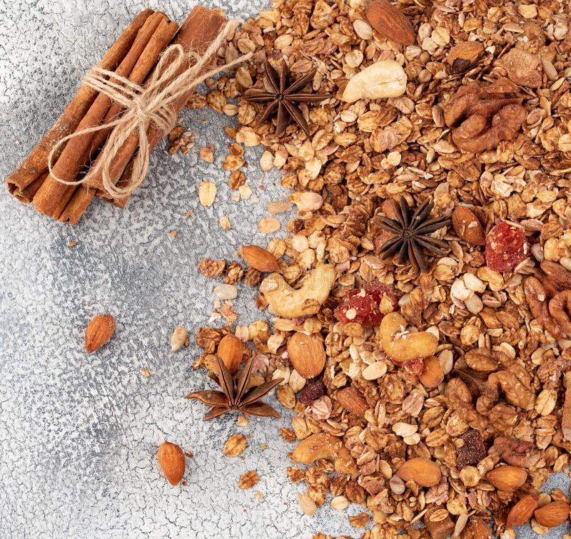 Organic homemade Granola Cereal with oats, almond, anise and cinnamon. Texture oatmeal granola or muesli as background. Top view stock image