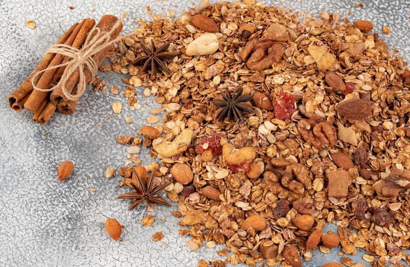 Organic homemade Granola Cereal with oats, almond, anise and cinnamon. Texture oatmeal granola or muesli as background. Top view royalty free stock images