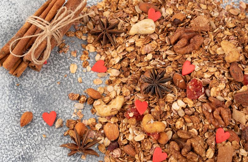 Organic homemade Granola Cereal with oats, almond, anise and cinnamon. Texture oatmeal granola or muesli as background. Top view stock photo