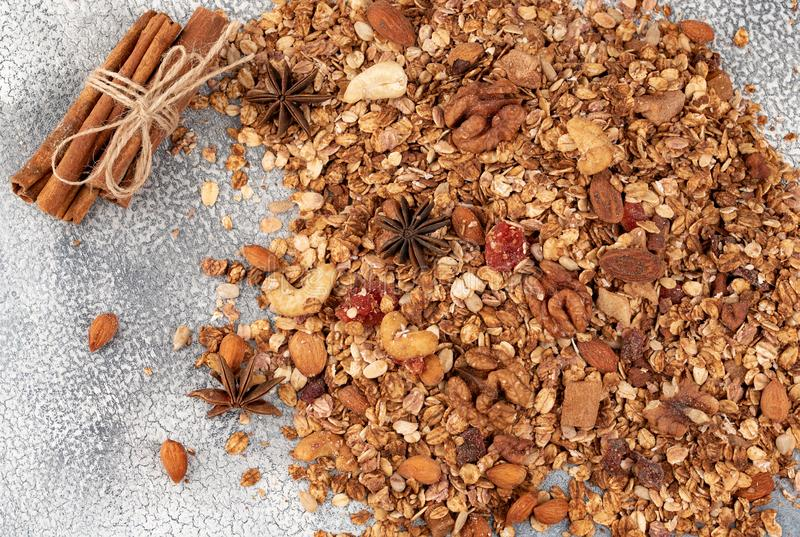 Organic homemade Granola Cereal with oats, almond, anise and cinnamon. Texture oatmeal granola or muesli as background. Top view stock photos