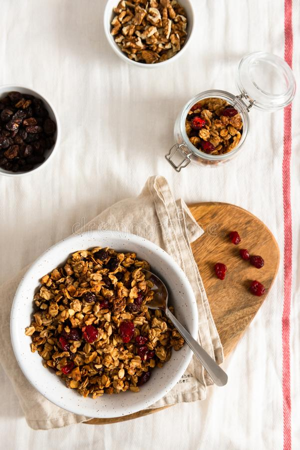 Organic homemade Granola Cereal with oats and walnuts. Oatmeal granola or muesli in bowl. Copy space for text royalty free stock photos