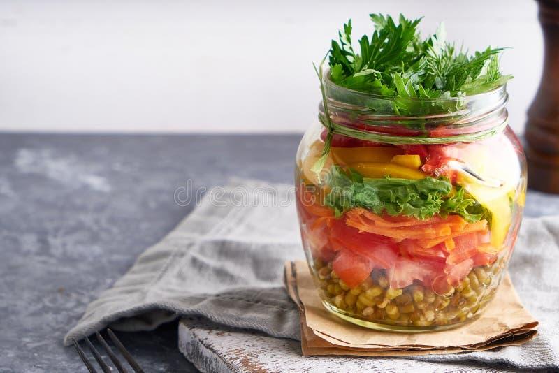Organic homemade salad served in jar, mason healthy food , copy space royalty free stock photos