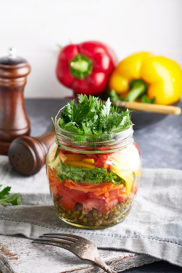 Organic homemade salad served in jar, mason healthy food , copy space stock images