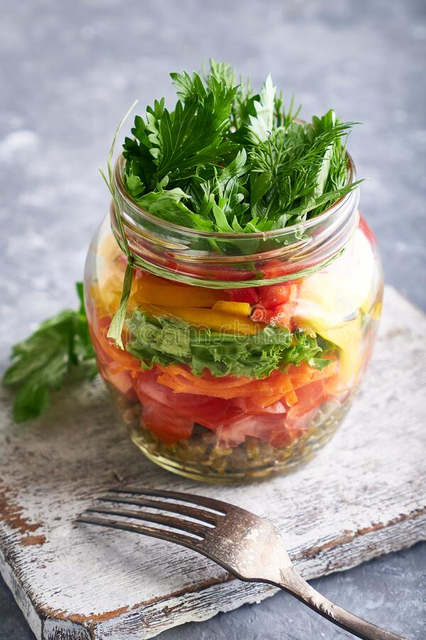Organic homemade salad served in jar, mason healthy food , copy space stock photography