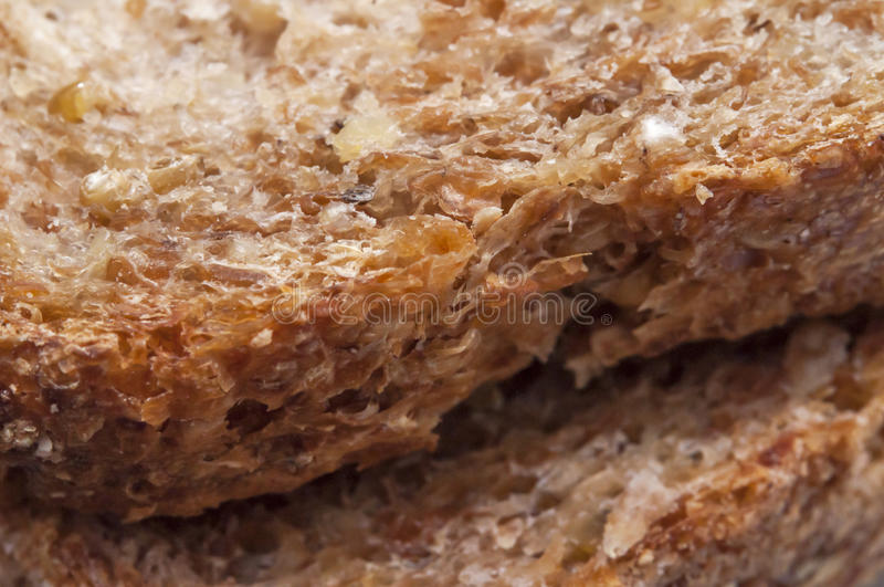 Organic live Sprouted Whole grain bread texture. Organic sprouted whole grain bread made from wheat, barley, beans, lentils , millet, and spelt royalty free stock photo