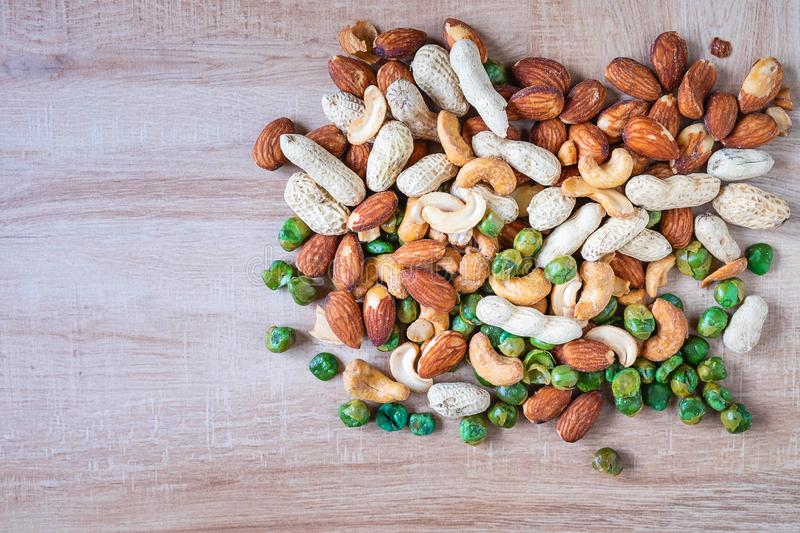 Organic mixed nuts on wooden table stock photo