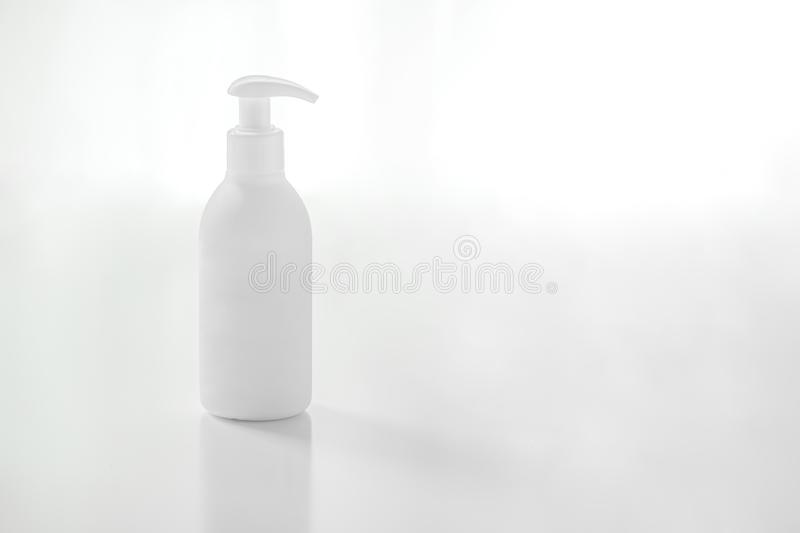 Organic natural cosmetic for baby, plastic bottle of bath cream, shampoo, lotion, shower gel, body milk on white background. royalty free stock photos