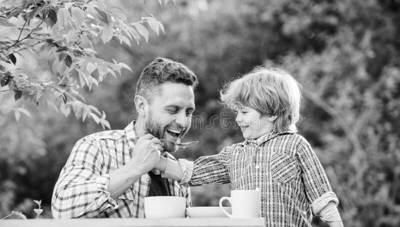 Organic and natural food. they love eating together. Weekend breakfast. father and son eat outdoor. small boy child with royalty free stock images