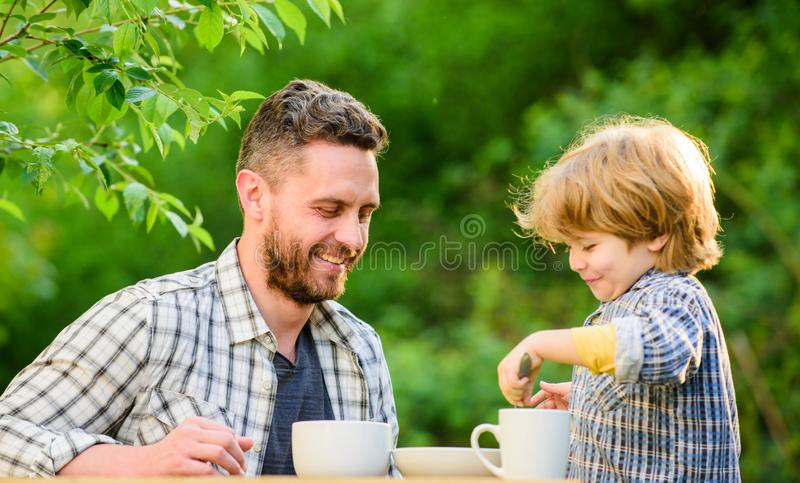 Organic and natural food. small boy child with dad. healthy food. Family day bonding. father and son eat outdoor. they. Love eating together. Weekend breakfast royalty free stock photography