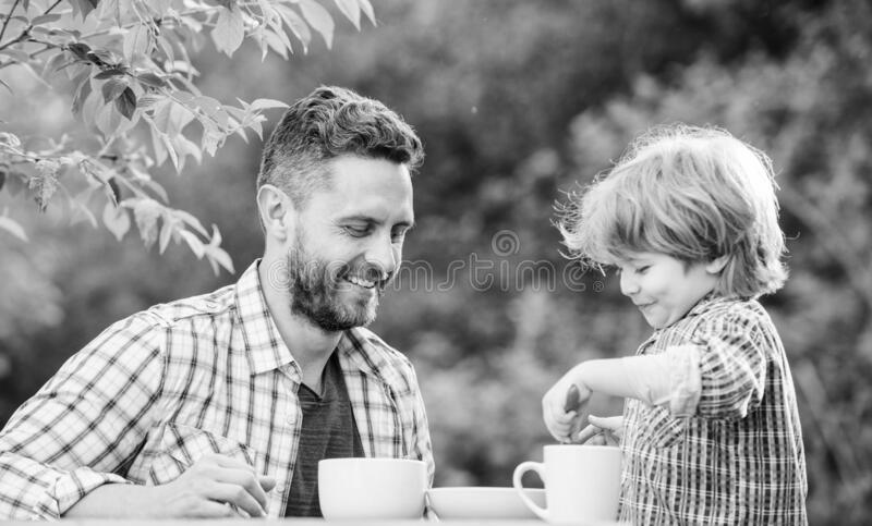 Organic and natural food. small boy child with dad. healthy food. Family day bonding. father and son eat outdoor. they royalty free stock photography