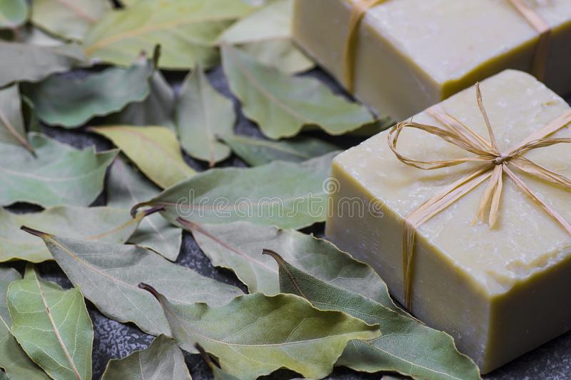 Organic natural handmade bay laurel soap with olive oil and leaves stock photography
