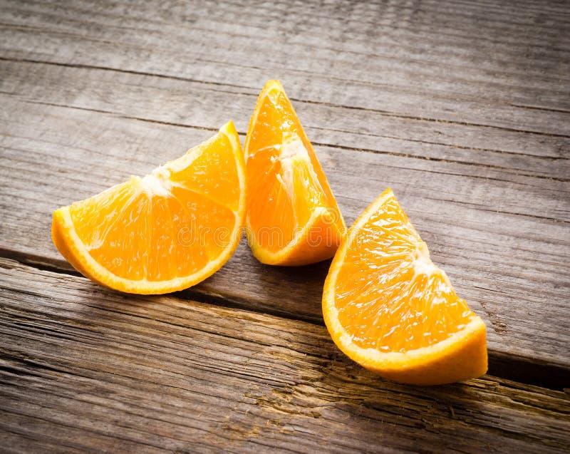 Download Organic Orange Fruit. Slices On Wooden Background Stock Image - Image: 37115839