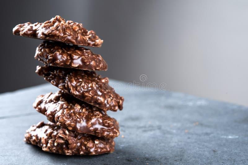 Organic peanut butter & Chocolate No Bake Cookies on a stone cutting board. Organic peanut butter & Chocolate, No Bake oatmeal Cookies on a stone cutting board stock image
