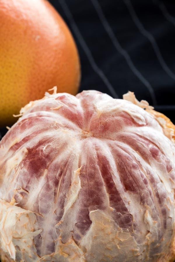 Organic peeled red grapefruit royalty free stock photos