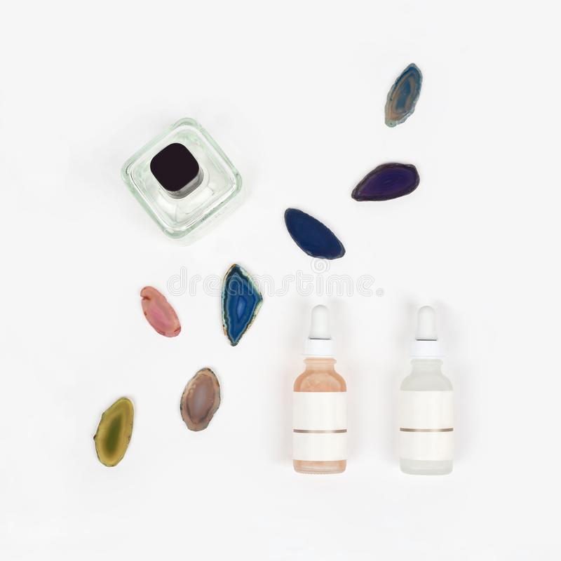 Organic pharmacy cosmetics with natural agate stone on white background. Flat lay. Top view of bottles of cream. Natural beauty stock images