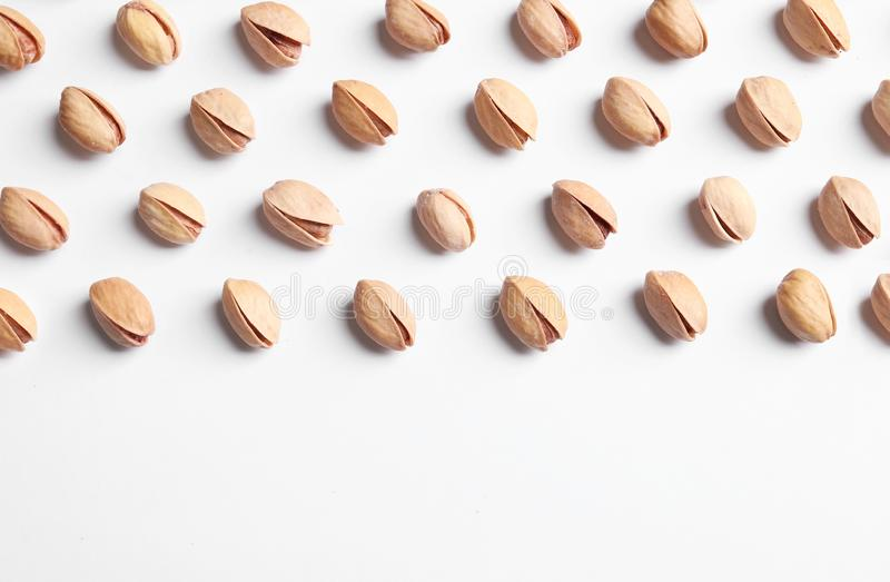Organic pistachio nuts on white background, flat lay. royalty free stock image