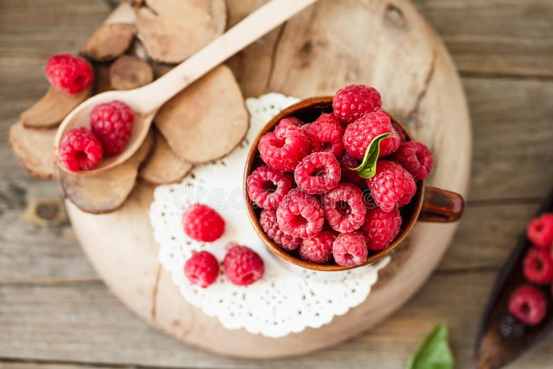 Organic raspberry with basil in a cup of coffee and a wooden sta stock images