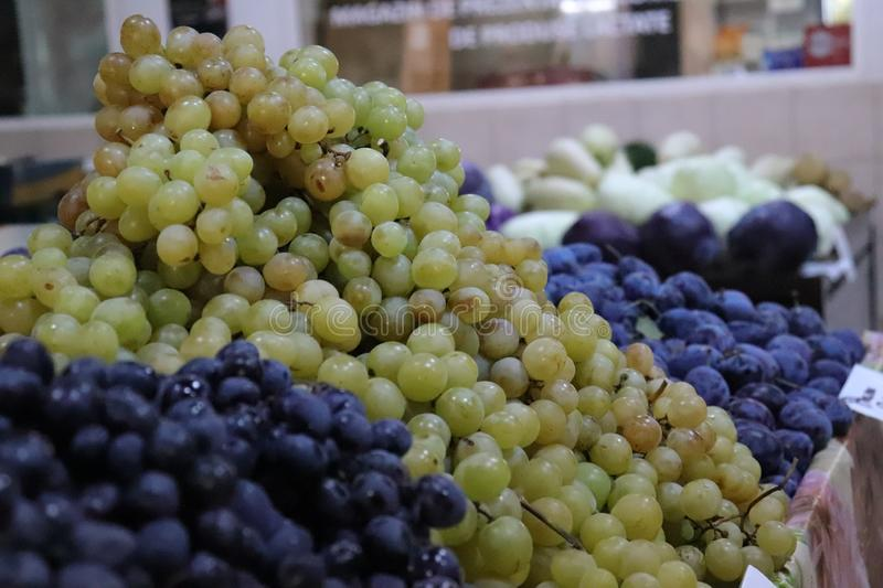 Organic red and white grapes in a farmers market stock images