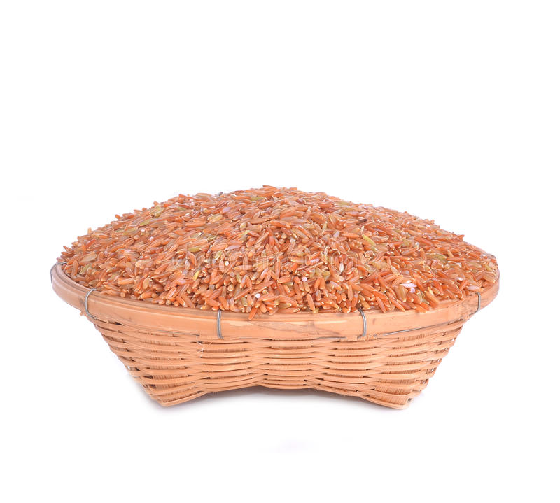 Organic rice on white background basket. Organic rice isolated on white background basket stock photos