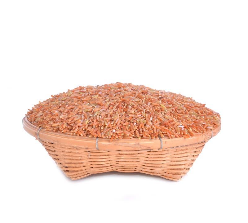 Organic rice on white background basket. Organic rice isolated on white background basket stock image