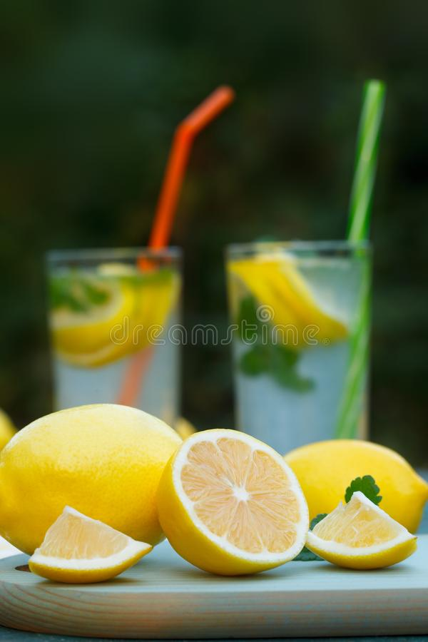 Organic, ripe lemons with Fresh lemonades stock photo