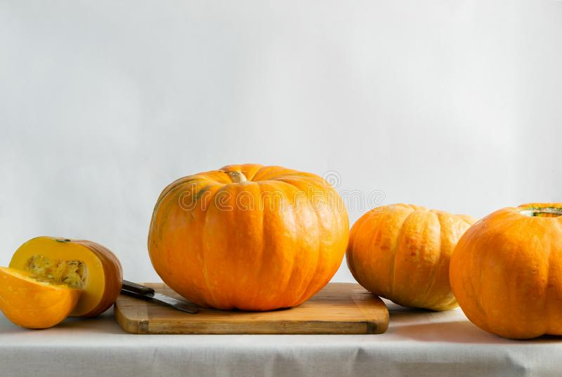 Organic ripe pumpkin kitchen table. Concept vegetarianism healthy clean ecological food. Selective focus. Copy space. Organic ripe pumpkin on the kitchen table royalty free stock photography