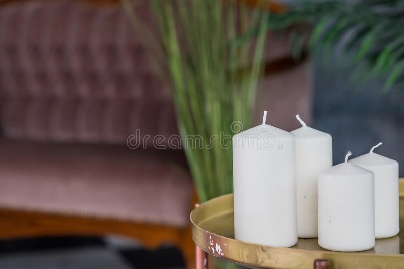 Organic scented soy candle on table. Loft interior decor, minimalism concept. Closeup, copy space.Cozy living room. Organic scented soy candle on grey concrete royalty free stock images