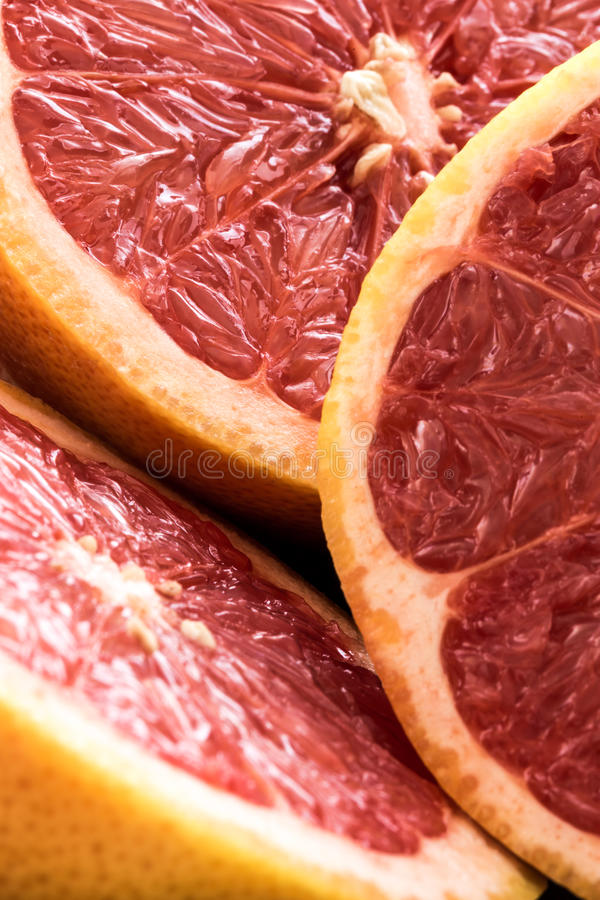 Organic sliced red grapefruits stock photo