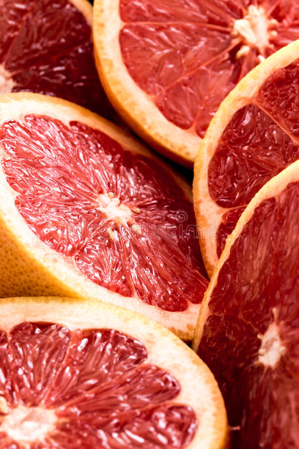 Organic sliced red grapefruits royalty free stock photography