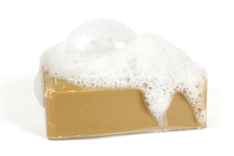 Organic soap on white. Organic soap with soap suds on top on a white background stock photos
