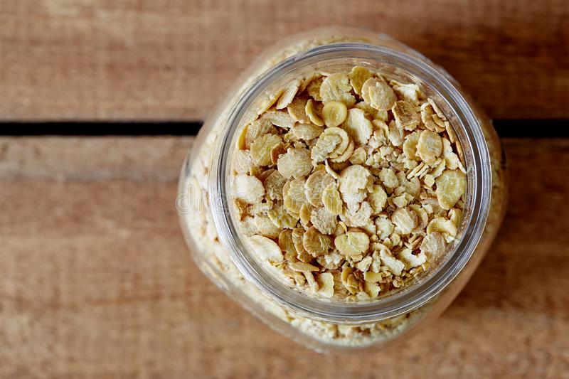Organic soy flakes in jar. Healthy nutrition focus foodie blogger royalty free stock images