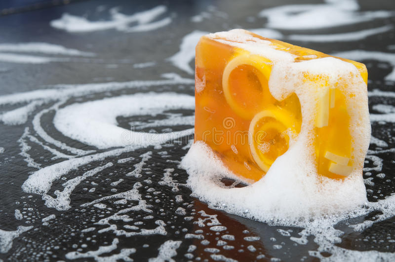 Organic spa soap with foam. Natural organic soap covered in foam stock photography