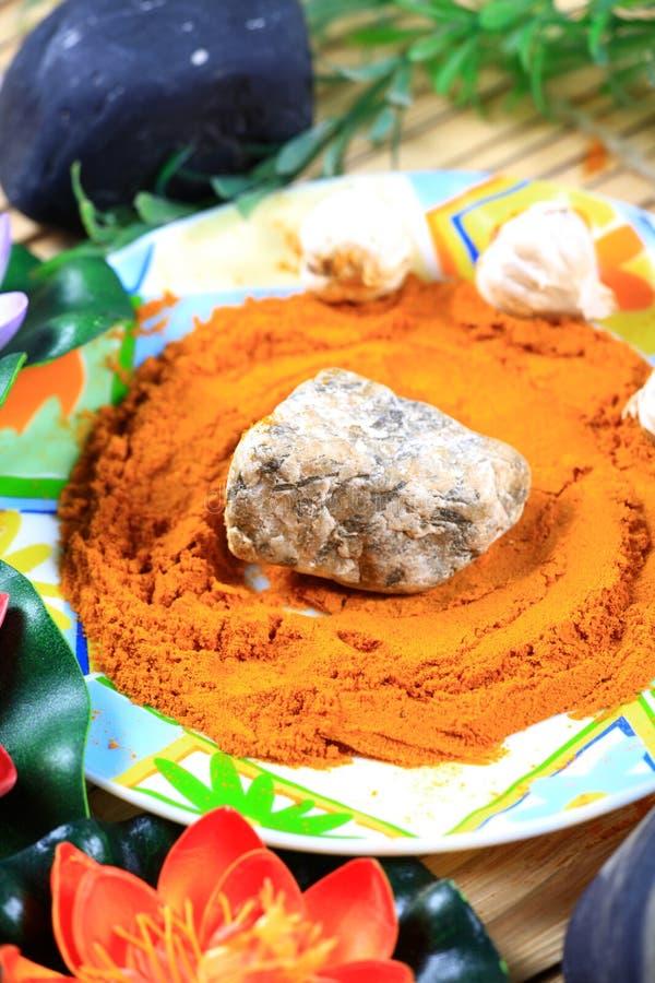 Download Organic Stone And Turmeric Massage Stock Photo - Image: 20553348