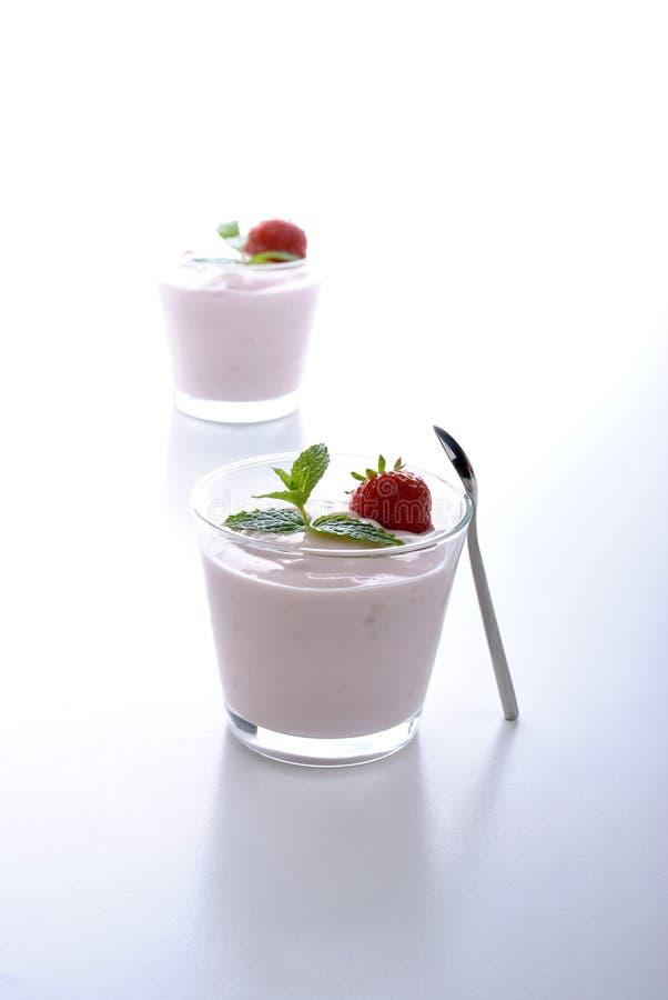 Organic strawberry in natural yogurt and mint stock photo