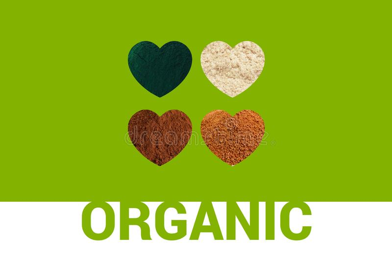 Organic text and four heart shapes. Hearts with spirulina powder, cacao powder, almond flour and coconut palm sugar stock image