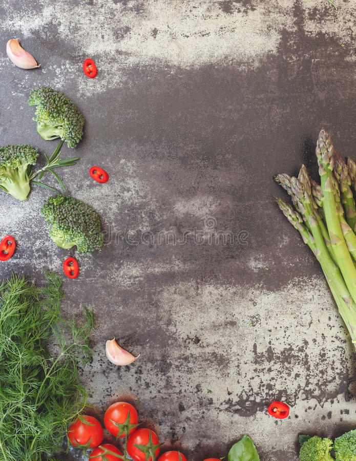 Organic vegetables cooking ingredients. Still life with various vegetables on concrete background, top view, vintage toned image, blank space royalty free stock image